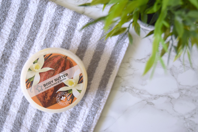vegan skincare product on towel on marble table with plant