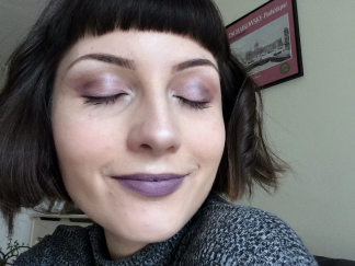 girl with closed eyes wearing purple lipstick