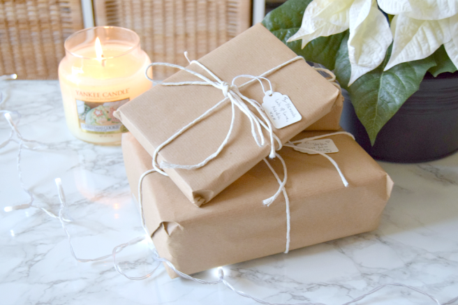 gifts wrapped in brown paper tied with string